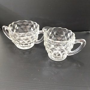 Pressed glass sugar bowl and creamer.